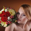 Young and beautiful bride standing with the flower bouquet  — Stock Photo #63093571