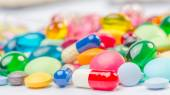 Many pills and tablets isolated on white background — Stock Photo