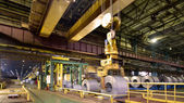 Loading of metal on a roll in the plant, steel coils — Stock Photo