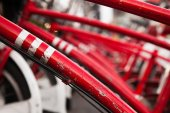 A lot of red bicycles on parking — Stock Photo
