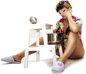 Curlers on her head housewife with soup ladle — Stock Photo