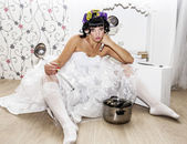 Curlers on her head bride with soup ladle — Stock Photo