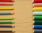 Color threads with pencils — Stock Photo