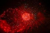 Celebrating firework in the black night sky — Stock Photo