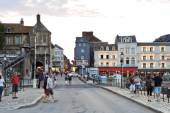 People on street in port of Honfleur town, France — Stock Photo