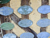 Old commemorative badges of cider producers — Stock Photo