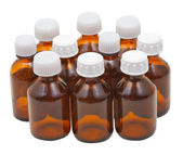 Many small closed brown glass pharmacy bottles — Stock Photo