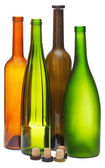 Colored empty open wine bottles and cork — Stock Photo