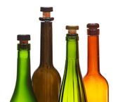 Four empty closed wine bottles close up — ストック写真