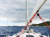 Voyage on yacht in Adriatic sea over rainy clouds — Stock Photo