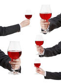 Set of red wine glass in businessman hand — Stock Photo