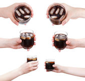 Set of hand holds soft drink with ice in glass — Stock Photo