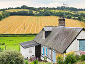 Peasant farm and harvested field in Normandy — Stock Photo