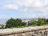 Tombelaine island and bay from mont saint-michel — Stock Photo