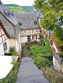 Typical houses on narrow street in German village — ストック写真
