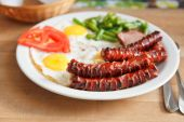 Plate with fried eggs, sausages, — Stock Photo