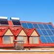 Solar Batteries and heaters on home roof — Stock Photo #56652289