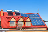 Solar Batteries and heaters on home roof — Foto Stock