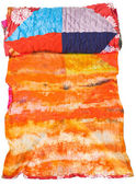 Rolled silk batik and patchwork scarf isolated — Stock Photo