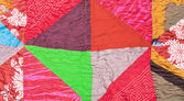 Geometric pattern of silk patchwork quilt — Stock Photo