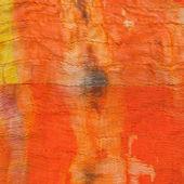 Texture of painted orange silk batik — Stock Photo
