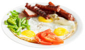 Fried eggs, sausages, tomato, beans on white plate — Stock Photo