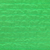 Green color textile background from stitched silk — Stock Photo