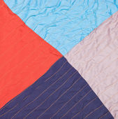 Square from triangles in stitched patchwork quilt — Stock Photo