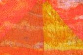 Triangle pattern on stitched orange silk batik — Stock Photo