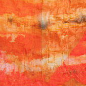 Background from abstract painted orange silk batik — Stock Photo