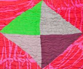 Geometric ornament of silk patchwork quilt — Stock Photo