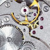 Background from steel mechanical clockwork — Stock Photo