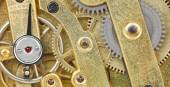 Background from brass mechanical clock movement — Stock Photo