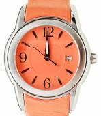 One minute to twelve o'clock on orange wristwatch — Stock Photo
