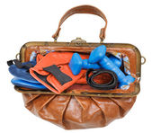 Female handbag with boxing gloves and dumbbells — Stock Photo