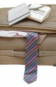 Sphygmomanometer on suitcase with ties close up — Stock Photo
