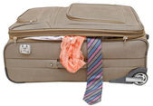 Suitcase with fell out male tie and female panties — Stock Photo