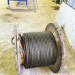 Wooden reel with steel rope in mechanical shop — Stock Photo #60168825
