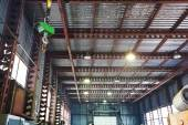 Hoist with bridge crane and scales in warehouse — Stock Photo