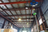 Hoist with overhead crane and scales in warehouse — Stock Photo