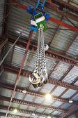 Hooks of weigher bridge crane in warehouse — Stock Photo