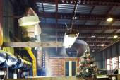 Decorated Christmas tree in workshop — Stock Photo