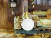 Workpiece and drill of boring machine close up — Stock Photo