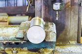 Metal part and drill of boring machine close up — Stock Photo