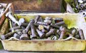 Many old bolts on workbench in turnery — Stock Photo