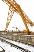Gantry cranes over railroad in outdoor warehouse — Stock Photo