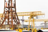 Tower and gantry cranes in metal product warehouse — Stock Photo