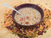 Mess of pottage in bowl with tablespoon on plate — Stock Photo