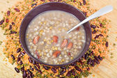 Top view of mess of pottage in bowl with tablespoon — Stock Photo