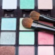 Makeup kit and cosmetic brushes — Stock Photo #63184153